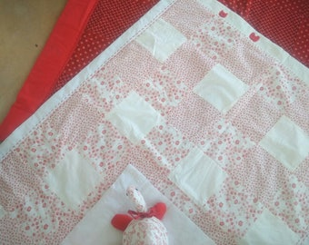 Patchwork baby quilt with soft tortoise and embroidered details