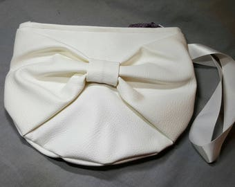 Faux leather bow clutch bag