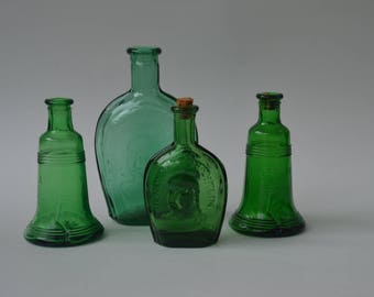 Miniature green colored glass bottles, vintage reproductions