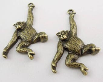 2 Breloques chimpanzés en métal bronze