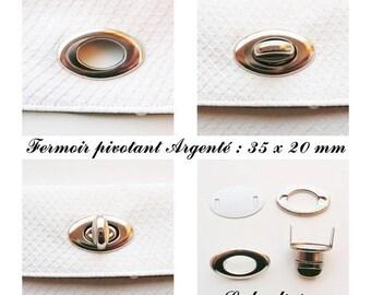 Clasp swivel oval turnstile bag / pouch / wallet Silver: 35 x 20 mm