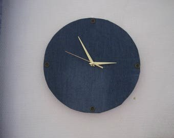 ROUND CLOCK HAS HANGING JEANS