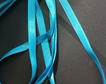 1 m of 6mm blue colored satin ribbon