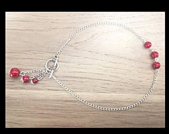 Anklet and red glass beads