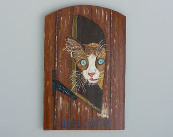 Acrylic painting on wood: cat from the head through the flap