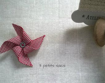 Fancy brooch, red and white/grey windmill. metal button