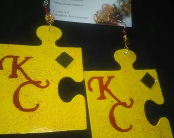 Hand painted wood puzzle piece KC earrings  with Chief colored swarovski crystals and real mirrors.