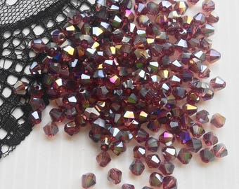 Swarovski Crystal, beautiful bi-cone beads, set of 10 beads 4 mm purple light AB (PBCVAB4)