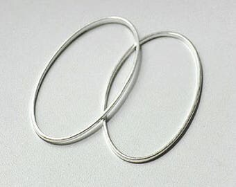 Set of 10 oval closed jump rings, brass, 16 x 9 mm, thickness: 1 mm