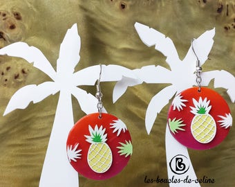 Earrings: yellow pineapple on a red orange gradient background
