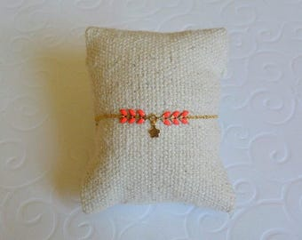 Spike flower coral and gold chain bracelet