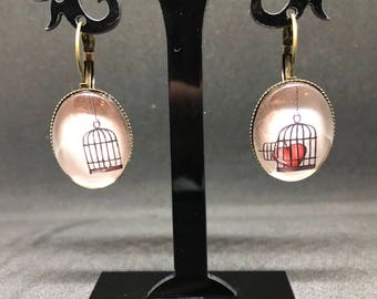 """Love in a cage"" earrings"