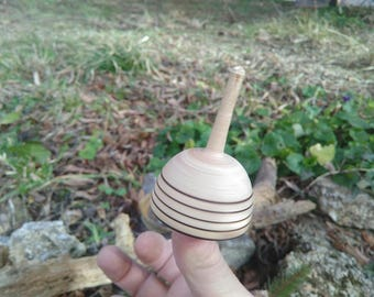 """Spinning wooden """"Mysterious Bell"""""""