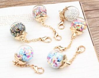 Beautiful glass pendant with glitter.