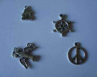 Four silver metal charms