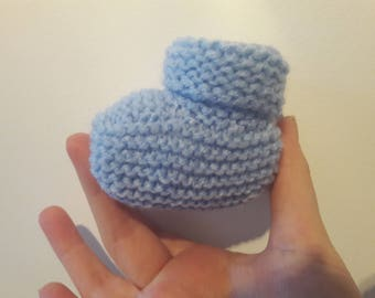 Simple blue knitted baby booties for newborn