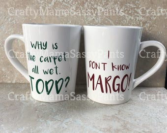 Couple's Christmas Mugs inspired by Christmas Vacation ~ Why is the carpet all wet Todd Mug ~ I don't know Margo Mug ~