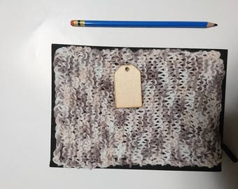 A5 hard cover notebook.  Grey, cream and white coloured hand knitted cover on front and back.