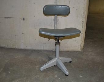 Grey vintage industrial chair with skai seats