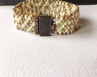 Beaded bracelet, antique copper box clasp, green beads, brown beads,one of a kind, lightweight bracelet. flexible bracelet