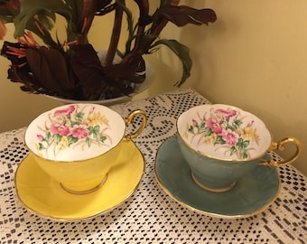 A pair of Rare Vintage Paragon Bone China made in England Teacup and Saucer Gold Trim Floral pattern