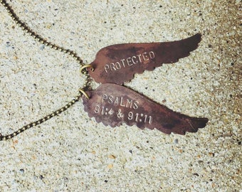 Protected bronze angel wings necklace