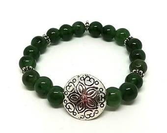 Green gemstone with metal findings.
