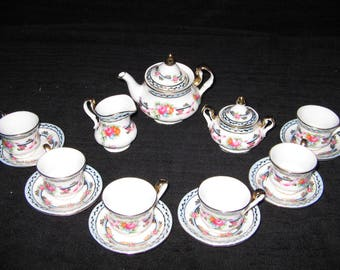 New Limoges France 17 PIECE  Child's Blue Tea Set with lots of flowers and gold trim