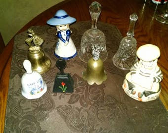 A bunch of vintage collectible Bells