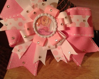 Pretty in Pink Sky from Paw Patrol surrounded by twinkling rhinestones topping off pink polka dot spikes  and a pink base bow.