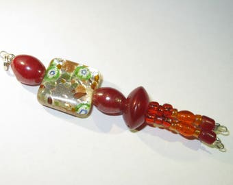 Rust and colourful glass beads: key ring, bag pendant, earring