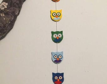 Handmade and hand-stitched rainbow owl hanging decoration