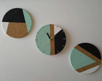 Decorative clock in three parts