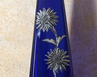 "Blue ""pyramid"" bottle/vase with floral deisgn"