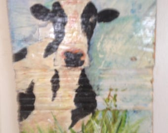 Painted cow on wood