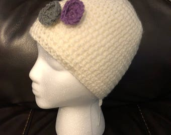 Crocheted hat with flower decoratioms.