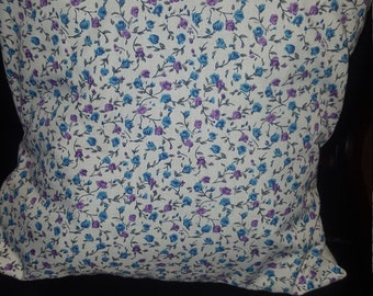 Blue floral throw pillow with plain white back
