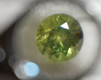0.37ct Bright Grassy Demantoid Garnet with Classic Horsetail