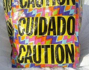 Bilingual Caution Bag