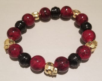 Dark Red/Black Glass beads with Gold plated skull heads