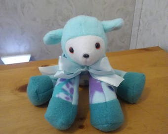 Lamb for baby boy nursery in shades of turquoise, purple n teal. Fleece. Hypoallergenic stuffing. Safety lock eyes n nose. 10 inches long.