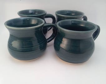Set of four beautifully made coffee mugs!! Wheel thrown and glazed fired to cone 5.