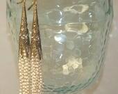 Creamy white tiny fresh water pearls and fancy brass tassle long pierced earrings