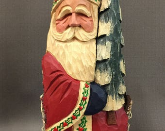 HAND CARVED original Santa holding a tree from 100 year old Cottonwood Bark.