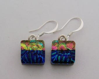 Tiny dichroic glass dangle earrings.