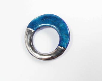 Ceramic brooch, turquoise and platinum ring.
