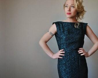 ANNIVERSARY SALE 1960s Black Wiggle dress, size extra small (00/0)