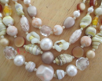 Vintage costume jewelry   / 4  strand beaded necklace
