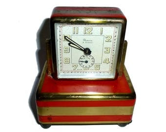 Art Deco Renova Desk Clock. Circa 1930s. Swiss Made Music Box Alarm. Manual Wind Clock Words. Music Box Works, too. Red and Gold Deco.