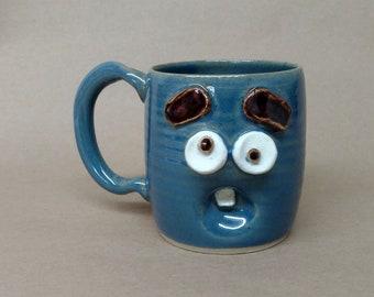 Nelson Studio Stoneware Pottery Cup. Worried Monday Morning Mug. Blue Stoneware Pottery Ceramic Mugs. Funny Overwhelmed Worried Face Mug.